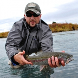 ERIC DALKE WITH A NICE RAINBOW TROUT CAUGHT ON A MOUSE PATTERN