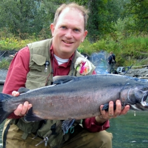 HENRY WITH A BIG BUCK SILVER SALMON